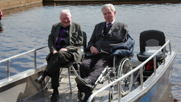 "LAPWD Members relaxing on the wheelchair accessible ""Wheelyboat"""